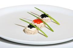 Caviar noir et rouge Image libre de droits