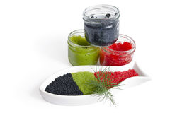 CAVIAR IN THE OPEN GLASS CONTAINERS. Caviar in a bowl-shaped over on withe background stock photos