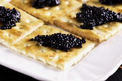 Caviar over crackers Royalty Free Stock Photo