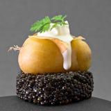 Caviar Potato. Caviar with potato and fresh cream Royalty Free Stock Photo