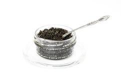 Caviar preto em um frasco com uma colher Imagens de Stock Royalty Free