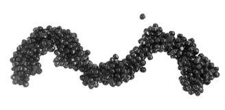 Caviar preto isolado no fundo branco imagens de stock royalty free