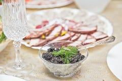 Caviar preto na tabela do feriado Fotos de Stock