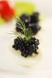 Caviar on a quail egg Stock Images