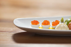 Caviar on quail eggs Stock Photos