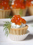Caviar red fish   in small tartlets. Stock Photos
