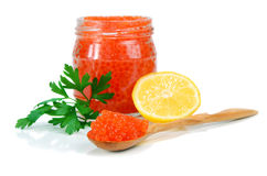 Caviar red in a glass jar with lemon and parsley Stock Photos