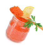 Caviar red in a glass jar with lemon and parsley Royalty Free Stock Images