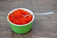 Caviar rojo con la cuchara Fotos de archivo libres de regalías