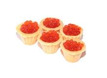 Caviar rojo delicioso y fresco en tartlets Fotografía de archivo libre de regalías