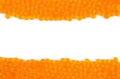 Caviar rojo en el fondo blanco Imagen de archivo libre de regalías
