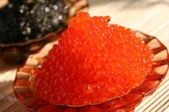 Caviar rouge et noir Photographie stock