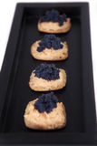 Caviar and salmon canape in tray. Caviar and salmon canape in wood tray Stock Photo