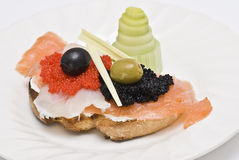 Caviar and smoked salmon on a toast. Royalty Free Stock Photography