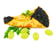 Caviar-stuffed pancake and grapes Royalty Free Stock Images
