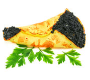 Caviar-stuffed pancake with greens. Isolated on a white background Stock Photos