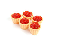 Caviar tartlets. Five  tartlets with bright red caviar white isolated Stock Photography