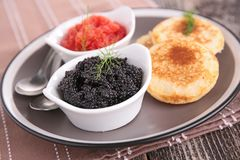 Caviar and toast. Close up on caviar and toast stock photography