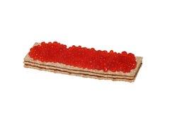 Caviar vermelho no pão estaladiço imagem de stock royalty free