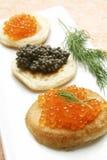 Caviar y blinis fotografía de archivo