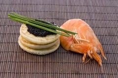 Caviar y camarón Foto de archivo