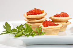 Caviare. Food series: red caviar for a taste and parsley Royalty Free Stock Photos