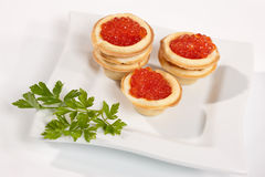 Caviare. Food series: red caviar for a taste and parsley Stock Image