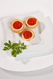 Caviare. Food series: red caviar for a taste and parsley Stock Images
