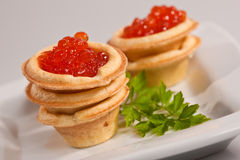 Caviare. Food series: red tasty caviar and fresh parsley Stock Photography