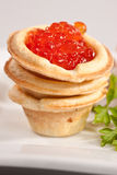 Caviare. Food series: red tasty caviar and fresh parsley Royalty Free Stock Photography