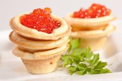 Caviare. Food series: red tasty caviar and fresh parsley Stock Image