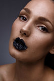 Caviare on lips Stock Image