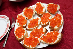 Caviare sandwiches. The caviare sandwiches on the plate at the restaurant Royalty Free Stock Images
