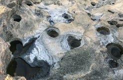 Cavidades e furos nas rochas fotografia de stock royalty free