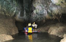 Caving with Canoe. Caving in Thailand Phang Nga Area royalty free stock photo