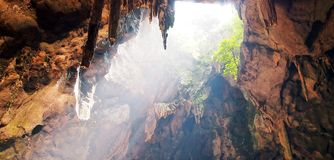 Caving cave sun beam sun ray Stock Images