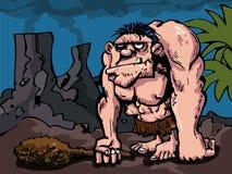 Cavman avec le grand club dans la configuration préhistorique Image stock