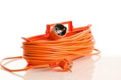 Cavo di estensione arancio isolato su bianco Fotografie Stock Libere da Diritti