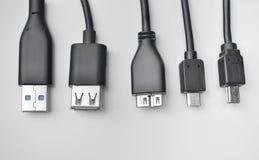 Cavo di USB, di mini-USB e di micro-USB Fotografie Stock Libere da Diritti