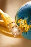 Cavo e globo di Ethernet Fotografie Stock