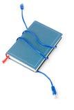 Cavo e libro della rete Fotografia Stock