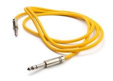 Cavo giallo della chitarra elettrica Fotografia Stock