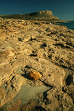 Cavo Greco. Beach rocks with cape Cavo Greco in the background on Cyprus Royalty Free Stock Images