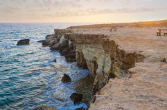 Cavo Greco. The scenic rocky cliffs of Cavo Greco in the lights of sunset, Cyprus Stock Photos
