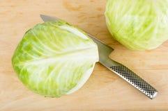 Cavolo e coltello Fotografia Stock