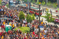 Cavs parade start. CLEVELAND, OH - JUNE 22, 2016: Crowds jam the streets at the start of the Cleveland Cavaliers' NBA championship parade, with participants on stock photography