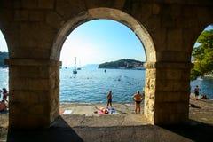 Coast of Cavtat. CAVTAT, CROATIA - JULY 20, 2017 : People swimming and sunbathing on the coast of Cavtat, Croatia Royalty Free Stock Photo