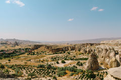 Cavusin old village, cave town in Cappadocia, Turkey Royalty Free Stock Photo