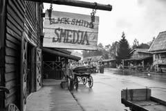Cawboy city blacksmith of western stock image