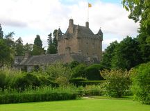 Cawdor Castle. A view of Cawdor Castle from its garden. This ancient tower house, 10 miles (16 km) east of Inverness and 5 miles (8 km) southwest of Nairn in royalty free stock image